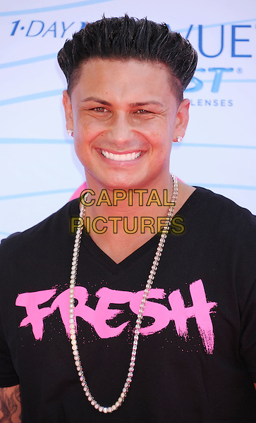 """Paul DelVecchio (aka. """"DJ Pauly D"""") of Jersey Shore.FOX's 2012 Teen Choice Awards held at The Gibson Ampitheatre in Universal City, California, USA..July 22nd, 2012.headshot portrait black t-shirt silver necklace fresh writing pink smiling.CAP/ROT/TM.©Tony Michaels/Roth Stock/Capital Pictures"""