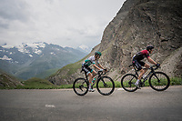 Emanuel Buchmann (DEU/BORA-hansgrohe) following defending Tour champion Geraint Thomas (GBR/Ineos) up the Col de l'Iseran (HC/2751m/13km@7.3%) <br /> > where the race was eventually stopped (at the top) because of landslides further up the road (after a severe hail storm in Tignes)<br /> <br /> Stage 19: Saint-Jean-de-Maurienne to Tignes (126km)<br /> 106th Tour de France 2019 (2.UWT)<br /> <br /> ©kramon
