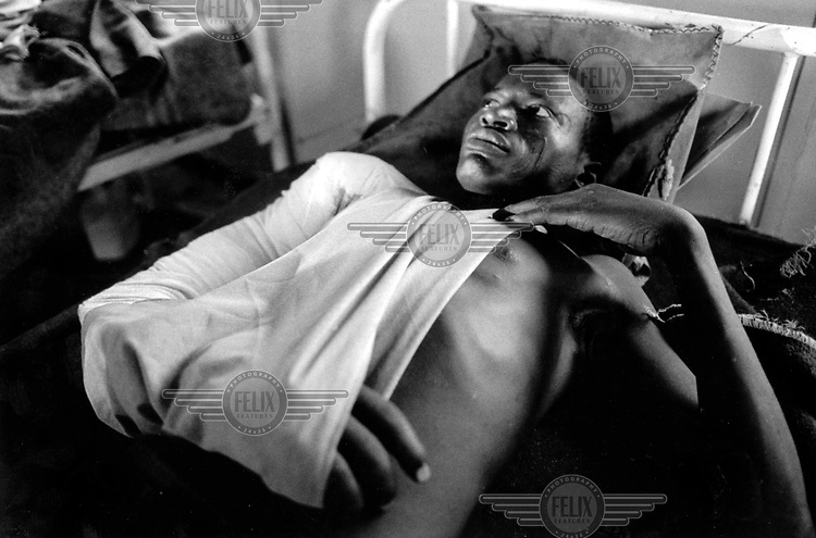 ©Crispin Hughes/Panos Pictures..Sudan. Wounded SPLA soldier at Nimule health centre, evacuated from Aswa hospital due to government bombing raids.