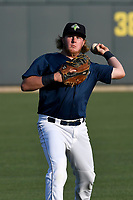 First baseman Dash Winningham (34) of the Columbia Fireflies warms up before a game against  the Charleston RiverDogs on Friday, June 9, 2017, at Spirit Communications Park in Columbia, South Carolina. Columbia won, 3-1. (Tom Priddy/Four Seam Images)