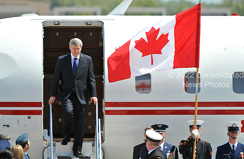 Canadian Prime Minister Stephen Harper arrives for the Nuclear Security Summit, at Andrews Air Force Base, Maryland, April 12, 2010.  .Credit: Kevin Dietsch / Pool via CNP