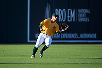 AZL Athletics Gold left fielder Rafael Rincones (8) catches a fly ball during an Arizona League game against the AZL Rangers on July 15, 2019 at Hohokam Stadium in Mesa, Arizona. The AZL Athletics Gold defeated the AZL Athletics Gold 9-8 in 11 innings. (Zachary Lucy/Four Seam Images)