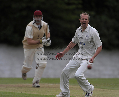 Scottish National Cricket League, Premier Division, Grange CC V Carlton CC at Raeburn Place, Edinburgh - Carlton captain and bowler Cedric English just fails to catch or stop a retruned ball from Grange batsman Stueart Davidson  - Picture by Donald MacLeod - 23 May 2009