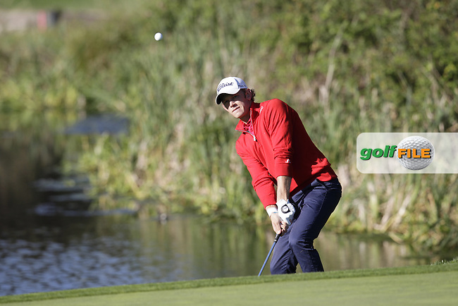 JB Hansen (DEN) chips onto the 4th green during Thursday's Round 1 of the 2014 Open de Espana held at the PGA Catalunya Resort, Girona, Spain. Wednesday 15th May 2014.<br /> Picture: Eoin Clarke www.golffile.ie