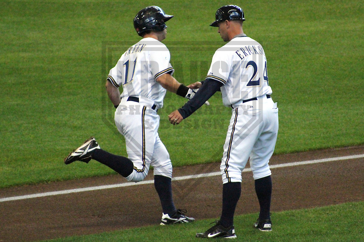 MILWAUKEE - APRIL 2011: Taylor Green (11) of the Milwaukee Brewers in congratulated by coach Matt Erickson (24) after hitting a home run during the team's Rising Stars game on Saturday April 3, 2011 at Miller Park in Milwaukee, Wisconsin. (Photo by Brad Krause) ..