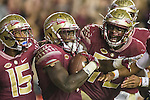 Florida State's Travis Rudolph (15) and Kareem Are (72) celebrate with Dalvin Cook after Cooks' 70 yard touchdown run in the second half of an NCAA college football game  against Clemson in Tallahassee, Fla., Saturday, Oct. 29,2016. Clemson defeated Florida State 37-34. (AP Photo/Mark Wallheiser)
