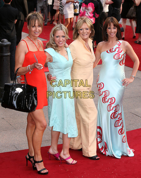 "CAROL McGIFFIN, JACKIE BRAMBLES, SHERRY HEWSON & ANDREA McLEAN.Arrivals at the ""Sex And The City: The Movie"" World Premiere, Odeon Leicester Square, London, England, UK. .May 12th 2008 .SATC full length Loose Women red blue turquoise yellow dress trouser suit black bag pink shoes black bag purse hand on hip.CAP/DS.©Dudley Smith/Capital Pictures"