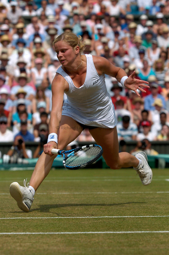 Photo: Richard Lane..Wimbledon Championships. 04/07/2006. .Kim Clijsters of Belgium returns.