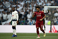 Liverpool's Mohamed Salah, right, celebrates past Tottenham Hotspur Danny Rose after scoring on a penalty kick during the UEFA Champions League final football match between Tottenham Hotspur and Liverpool at Madrid's Wanda Metropolitano Stadium, Spain, June 1, 2019.<br /> UPDATE IMAGES PRESS/Isabella Bonotto