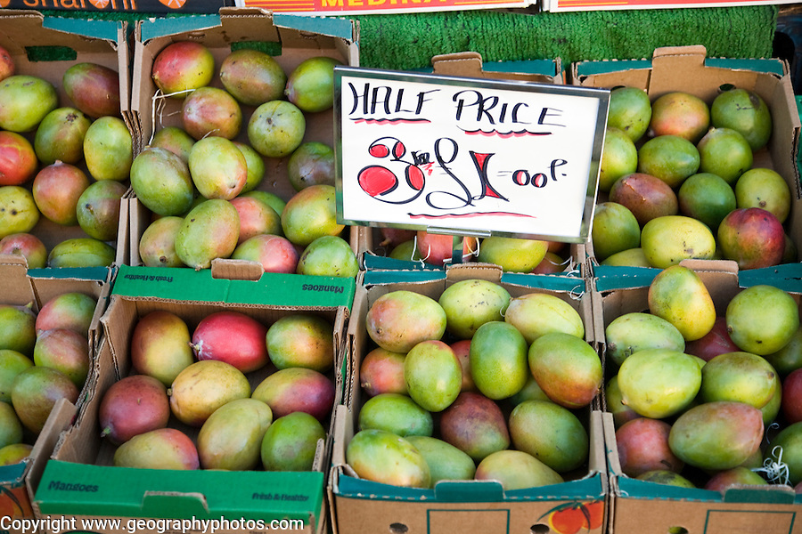 Half price mangoes for sale market stall three for one pound sterling