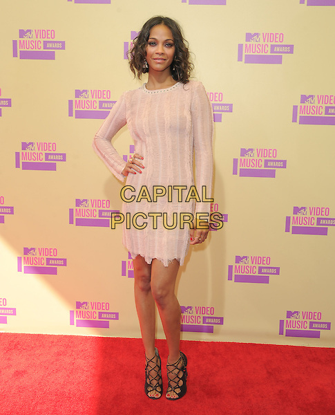 Zoe Saldana.Arrivals at The 2012 MTV Video Music Awards held at Staples Center in Los Angeles, California, USA..September 6th, 2012.VMA's VMAS VMA full length beige dress long sleeves hand on hip fringed                                                     .CAP/DVS.©DVS/Capital Pictures.