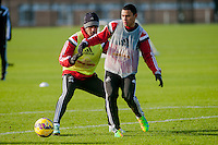 SWANSEA, WALES - JANUARY 28:  Kyle Naughton of Swansea City  and Jefferson Montero of Swansea City play for the ball during training on January 28, 2015 in Swansea, Wales.