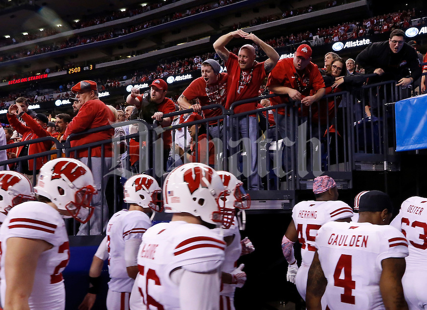 Ohio State fans heckle Wisconsin Badgers players as they head to the locker room for halftime of the Big Ten Championship game at Lucas Oil Stadium in Indianapolis on Dec. 6, 2014. (Adam Cairns / The Columbus Dispatch)