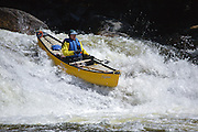 Canoe going over Lower Falls along the Swift River during the spring months in the White Mountains, New Hampshire USA