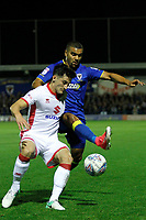 Milton Keynes' George Williams is closed down by AFC Wimbledon's Liam Trotter during the Sky Bet League 1 match between AFC Wimbledon and MK Dons at the Cherry Red Records Stadium, Kingston, England on 22 September 2017. Photo by Carlton Myrie / PRiME Media Images.