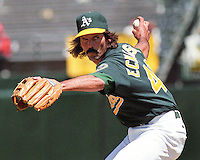 Oakland Athletics closer Dennis Eckersley delivers a strike. (1995 photo by Ron Riesterer)