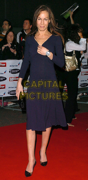 TARA PALMER TOMKINSON.Pride of Britain Awards 2005, London.October 10th, 2005.Ref: CAN.full length black dress.www.capitalpictures.com.sales@capitalpictures.com.©Capital Pictures