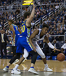 Nevada forward Jordan Brown (21) loses the ball as he is stopped on the baseline by San Jose State forward Noah Baumann (20) in the first half of an NCAA college basketball game in Reno, Nev., Wednesday, Jan. 9, 2019. (AP Photo/Tom R. Smedes)