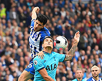 Dale Stephens of Brighton and Hove Albion wins a head er from Erik Lamela of Tottenham Hotspur during Brighton & Hove Albion vs Tottenham Hotspur, Premier League Football at the American Express Community Stadium on 5th October 2019