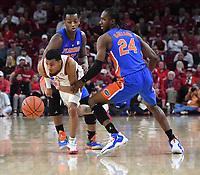 NWA Democrat-Gazette/J.T. WAMPLER Arkansas' Jalen Harris gets by Florida's Keith Stone (LEFT) and Deaundrae Ballard Wednesday Jan. 9, 2019 at Bud Walton Arena in Fayetteville. Arkansas lost 57-51.