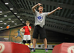 SIOUX FALLS, SD - JULY 2:  Josh Siegfried instructs players where to go for drills as Zane Rollag looks on during a camp at the Riggs Football Academy Tuesday night at the Sanford Fieldhouse. (Photo by Dave Eggen/Inertia)
