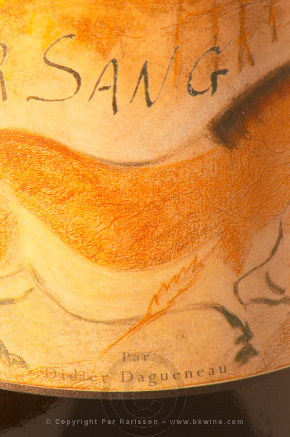 A bottle of Pouilly Fume Pur Sang (pure full blood) the label showing a horse looking like a cave painting, by Didier Dagueneau, an organic wine producer, close-up of the label - Loire Valley, France