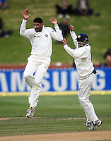 India's Harbahjan Singh celebrates dismissing Jesse Ryder with Gautam Gambhir during day four of the 3rd test between the New Zealand Black Caps and India at Allied Prime Basin Reserve, Wellington, New Zealand on Monday, 6 April 2009. Photo: Dave Lintott / lintottphoto.co.nz.