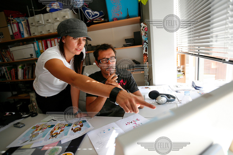 Marketing director for Roxy,  Stine Brun Kjeldaas, is a former snowboard professional and Olympic silver medalist. Here she is seen working with the design department in the Roxy Europe headquarters in Saint Jean de Luz. Near Biarritz, France.
