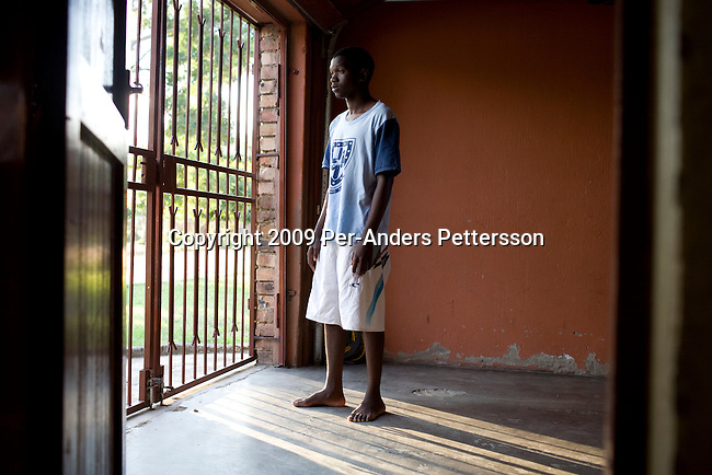 NELSPRUIT, SOUTH AFRICA FEBRUARY 18: Tshipiso Mohalala, age 19, stands in the family driveway on February 18, 2009 in Nelspruit, South Africa. His father, Jimmy Mohalala was shot and killed a few months ago and unknown attackers wounded Tshipiso. The father had uncovered corruption with the building of the new stadium for the 2010 Soccer World Cup. Nelspruit is one of the host cities for the event. The project has been affected by strikes and many delays. (Photo by Per-Anders Pettersson/Getty Images).