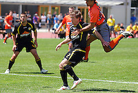 Waikato's Joe Simpkins lands on Adam Birch to provoke the retaliation for which Birch was sent off..NZFC soccer  - Team Wellington v Waikato FC at Newtown Park, Wellington. Sunday, 20 December 2009. Photo: Dave Lintott/lintottphoto.co.nz