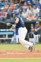 Asheville Tourists designated hitter Brian Mundell (15) swings at a pitch during a game against the Augusta GreenJackets at McCormick Field on August 6, 2016 in Asheville, North Carolina. The GreenJackets defeated the Tourists 11-4. (Tony Farlow/Four Seam Images)