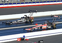 Feb 8, 2015; Pomona, CA, USA; NHRA top fuel driver Leah Pritchett (near) races alongside Brittany Force during the Winternationals at Auto Club Raceway at Pomona. Mandatory Credit: Mark J. Rebilas-USA TODAY Sports