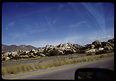 Taken from car window.  R.R. track and road bed along side highway. Mt reflections in car windshield.<br /> D&amp;RGW