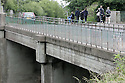 Youths cross over the Arthur Road bridge linking the Longlands Estate to Whitewell Road area and Hazelwood Integrated Primary School in North Belfast. The school is due to have a peace line built inside the school grounds, in a bid to keep rival youths from the Whitewell Road area away from a small mixed housing estate of Old Throne Park. Photo/Paul McErlane.