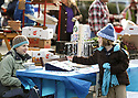 The Poulsbo Farmers Market is in its final weeks in downtown Poulsbo. The popular market extended its season into mid-december. Melissa Rogers and her daughter Hayden, 7, set up custom jewlery from Blue Dolphin Beads Satuday. Brad Camp | For the Kitsap Sun