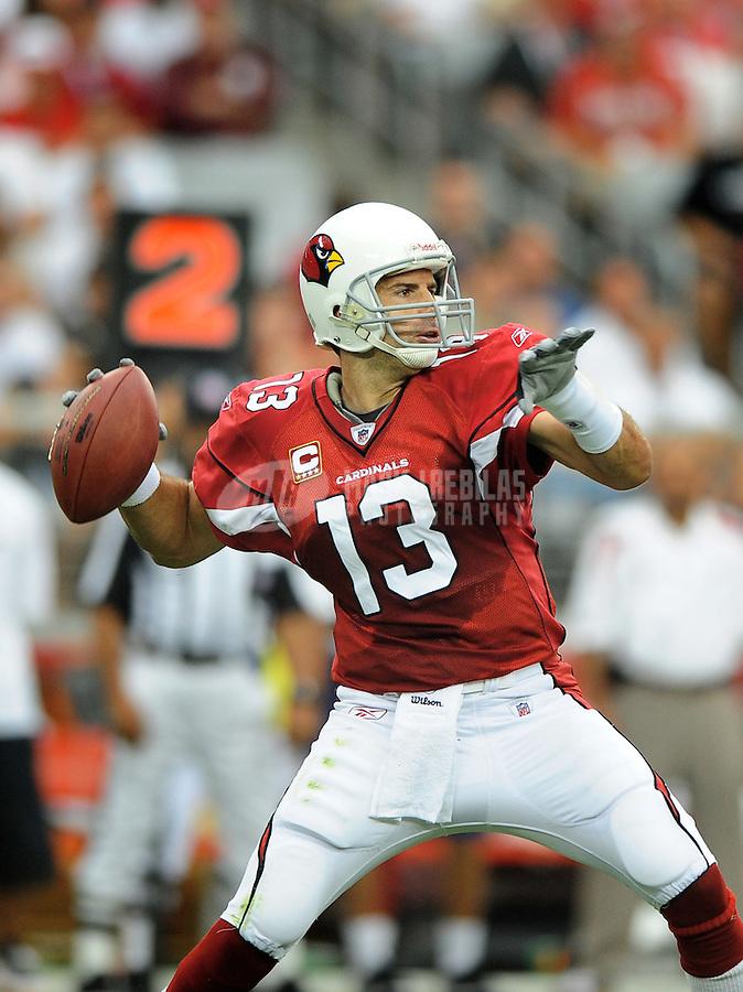 Sept. 14, 2008; Glendale, AZ, USA; Arizona Cardinals quarterback (13) Kurt Warner throws a pass against the Miami Dolphins at University of Phoenix Stadium. Mandatory Credit: Mark J. Rebilas-