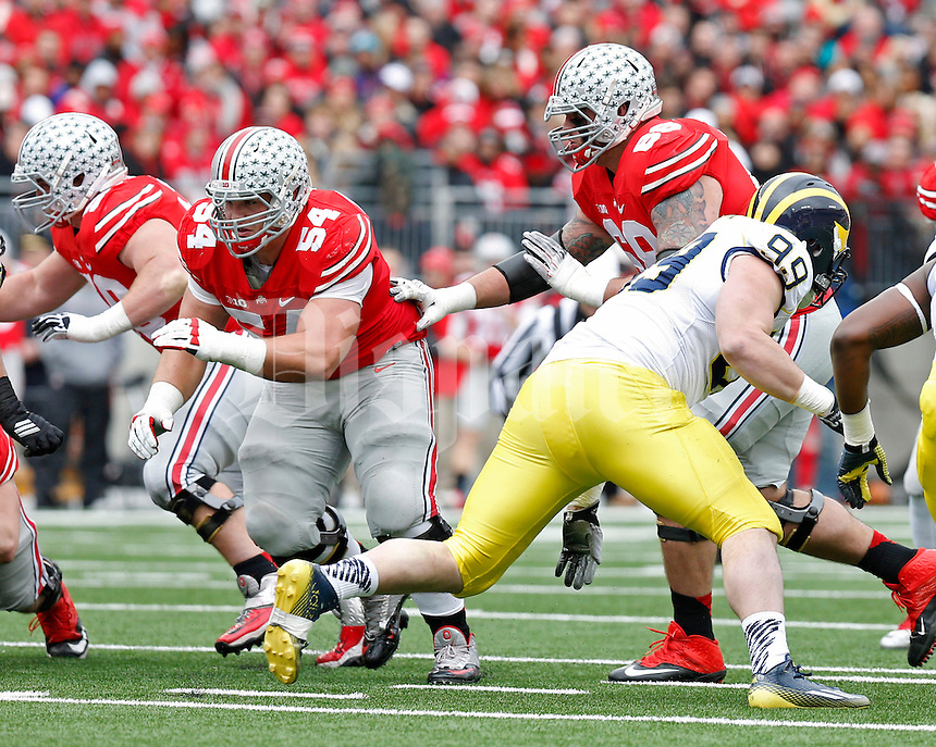Ohio State Buckeyes offensive lineman Billy Price (54) and Ohio State Buckeyes offensive lineman Taylor Decker (68) against Michigan Wolverines at Ohio Stadium in Columbus, Ohio on November 29, 2014.  (Dispatch photo by Kyle Robertson)