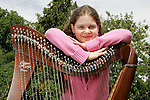 16/08/06 Emer Coughlan from Tulla who is a grandaughter of of Paddy Canny.  Emer studies the harp with Janet Harbison in Limerick and she recently won 4 Muster 1st prizes and will go on to the All Ireland Finals in Letterkenny on August 26th. Pic: Don Moloney / Press 22