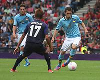 Men's Olympic Football match Spain v Japan on 26.7.12...Jordi Alba of Spain running at Hiroshi Kiyotake of Japan, during the Spain v Japan Men's Olympic Football match at Hampden Park, Glasgow..........