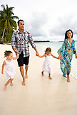 INDONESIA, Mentawai Islands, Kandui Resort, family walking on the beach