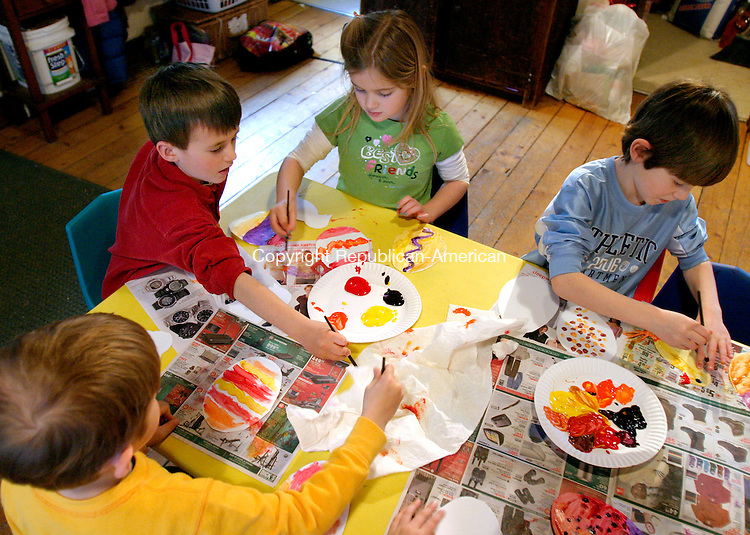 WOODBURY, CT--05 APRIL 2007--040507JS11-Students, clockwise from left, Dylan Albert, Lindsey Ross, Jack Winegard and Zack Hoedl paint paper Easter eggs during Thursday's Children's Farming program at the Flanders Nature Center in Woodbury. FOR COUNTRY LIFE<br /> Jim Shannon / Republican-American