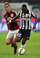 Calcio, Serie A: Milan vs Juventus, Milano, stadio San Siro, 20 settembre 2014.<br /> Juventus midfielder Kwadwo Asamoah, of Ghana, is challenged by AC Milan forward Keisuke Honda, of Japan, left, during the Italian Serie A football match between AC Milan and Juventus at Milan's San Siro stadium, 20 September 2014.<br /> UPDATE IMAGES PRESS/Isabella Bonotto