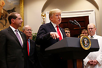 United States President Donald J. Trump speaks during the signing ceremony for S. 2553 &quot;Know the Lowest Price Act&quot; and S. 2554 &quot;Patients Right to Know Drug Prices Act&quot;, in the Roosevelt Room of the White House, Washington, DC, October 10, 2018. At left of the President is United States Secretary of Health and Human Services (HHS) Alex Azar and US Senator Lamar Alexander (Republican of Tennessee)<br /> <br /> CAP/MPI/RS<br /> &copy;RS/MPI/Capital Pictures