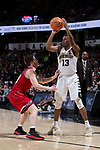 Bryant Crawford (13) of the Wake Forest Demon Deacons looks to pass over Braxton Beverly (10) of the North Carolina State Wolfpack during second half action at the LJVM Coliseum on February 17, 2018 in Winston-Salem, North Carolina.  The Wolfpack defeated the Demon Deacons 90-84.  (Brian Westerholt/Sports On Film)