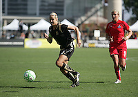 Leslie Osborne (10) controls the ball ahead of Allie Long (9). Washington Freedom defeated FC Gold Pride 4-3 at Buck Shaw Stadium in Santa Clara, California on April 26, 2009.
