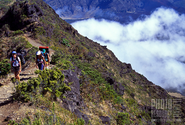 Three backpackers hiking through Haleakala National park, Maui