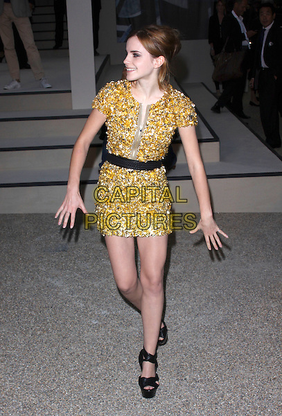 EMMA WATSON .Attending the Burberry Closing Party for London Fashion Week held at Chelsea College for Art & Design, London, England, UK, .September 22nd 2009..full length gold silver studded embellished jewel encrusted zip dress black waistband sandals hands walking funny profile open toe platform .CAP/AH.©Adam Houghton/Capital Pictures.