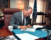 United States Secretary of Defense Dick Cheney signs documents authorizing wider use of the United States Military in combating the importation of illegal drugs into the United States at the Pentagon in Washington, DC on October 19, 1989.<br />