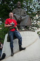 Moscow, Russia, 12/05/2012..A protester under the statue of Kazakh poet Abai Kunanbaev and wearing a Guinness t-shirt shouts that demonstrators should not drink alcohol in Chistiye Prudy, or Clean Ponds, a park in central Moscow were some 200 opposition activists have set up camp.