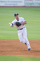 Chattanooga Lookouts shortstop Corey Seager (12) makes a throw to first base against the Montgomery Biscuits at AT&T Field on July 24, 2014 in Chattanooga, Tennessee.  The Biscuits defeated the Lookouts 6-4. (Brian Westerholt/Four Seam Images)